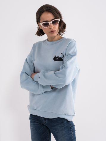 Ženska pulover z minimalističnim tiskom