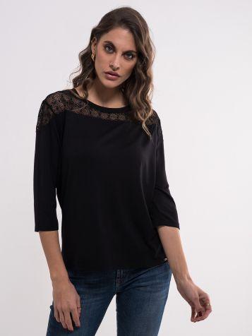 Ženska majica sa providnim detaljem